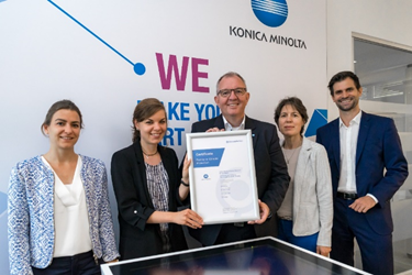 internal carbon offsetting at Konica Minolta